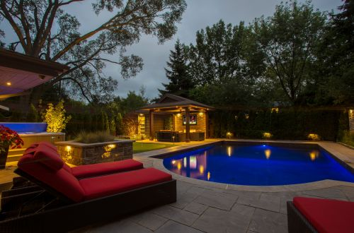 Chaise and pool at night